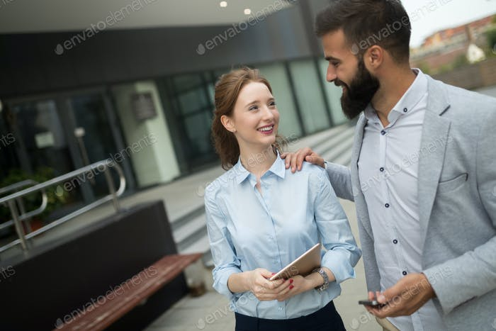 Picture of handsome businessman and attractive businesswoman