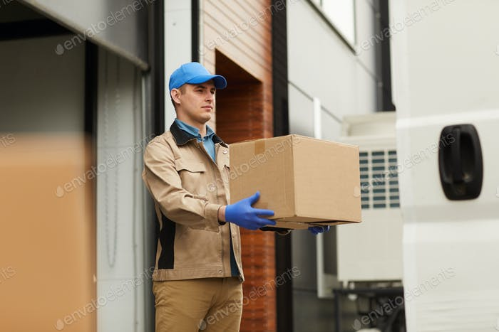 Courier carrying parcel