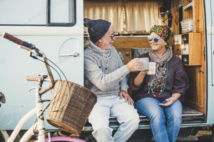 Happy cheerful mature people couple caucasian traceler enjoy and take a break resting