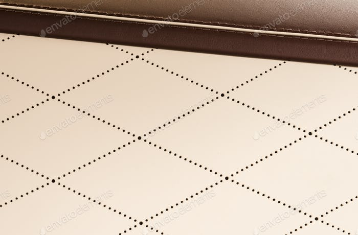Part of perforated white and red  leather