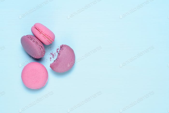Macaroons on blue table close-up