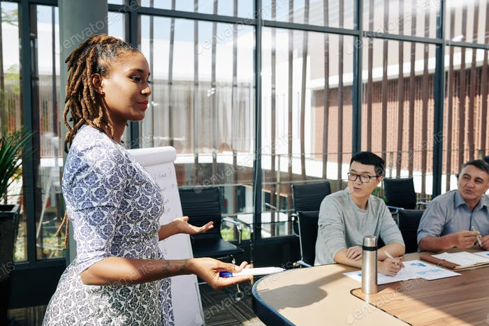 Businesswoman explaining strategy of development
