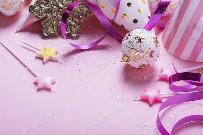 card with christmas decoration in pink background