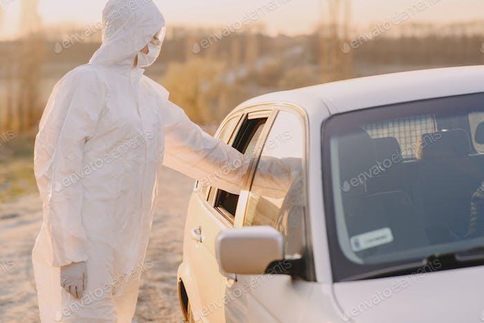 Person in a protective suit checks the temperature