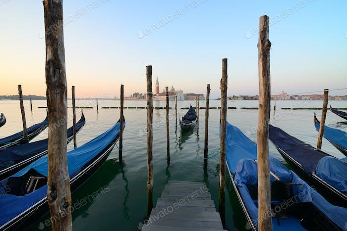 Gondolas and wooden pier
