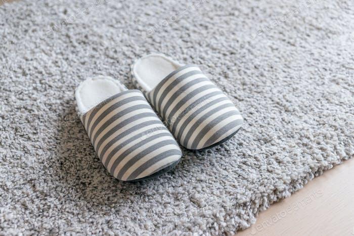 Slipper on carpet at home