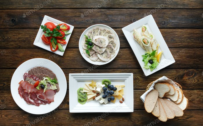 Restaurant food. Dishes served at wooden table