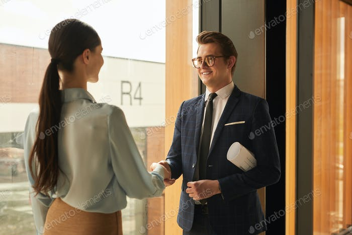 Rebtal Agent Shaking Hands with Client