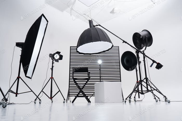 Modern photo studio with professional equipment. White cyclorama.