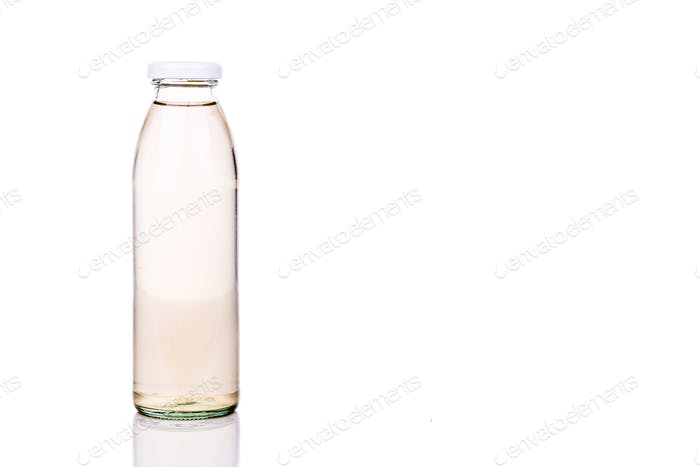 Three translucent liquid in glass bottle on white background