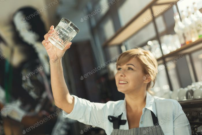 Portrait of experienced barista at coffee shop counter