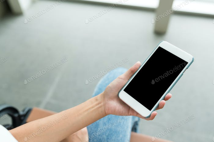 Holding cellphone with blank screen