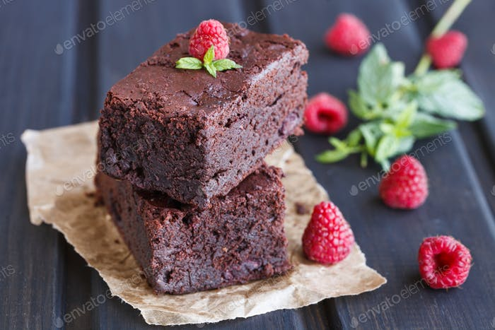 Chocolate brownie with raspberries.