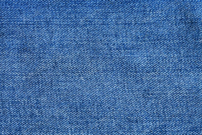 blue texture of denim fabric close up
