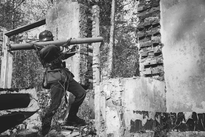 German Wehrmacht Infantry Soldier In World War II Open Fire From
