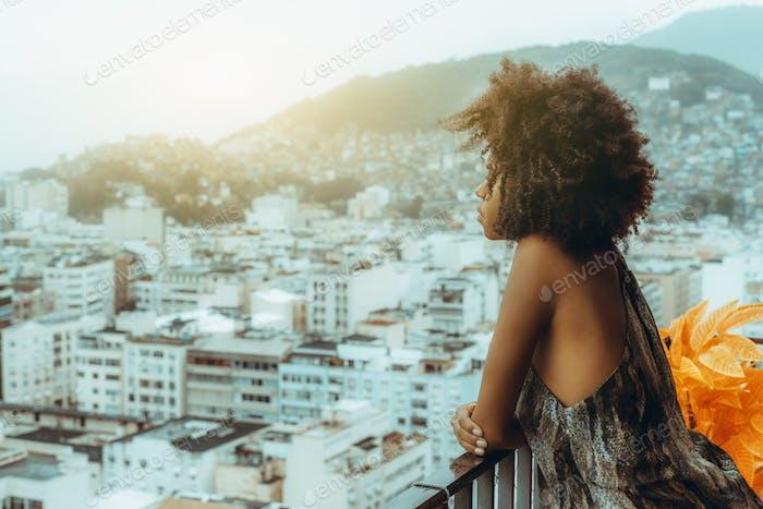 A girl on the balcony, urban skyline