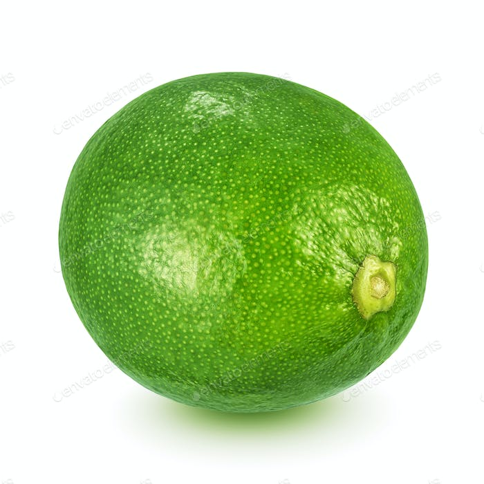 Whole lime with leaf isolated on white background