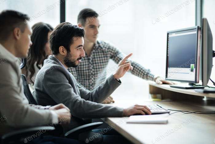 Thumbnail for Software engineers working in office on project together
