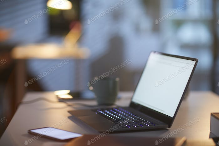 Workplace with laptop at office