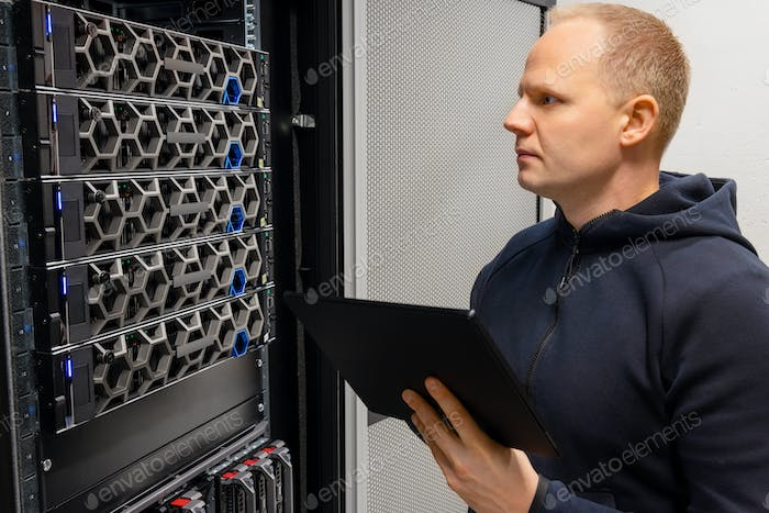 Technical Consultant With Digital Tablet Monitor Hyperconverged Servers Environment in Datacenter