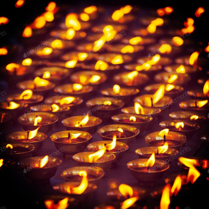 Burning candles in Buddhist temple, McLeod Ganj
