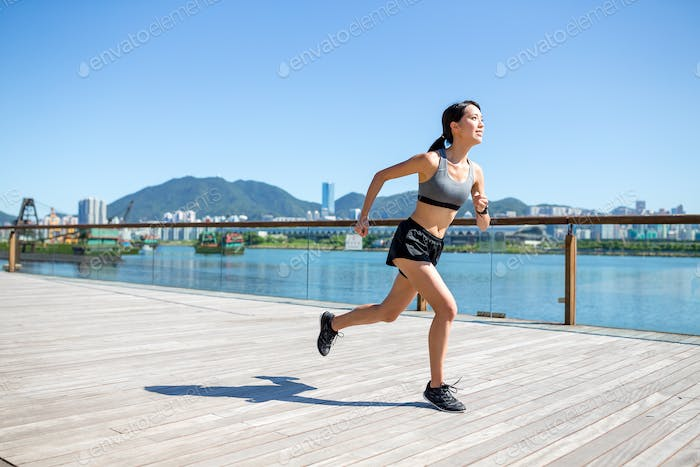 Woman enjoy city running