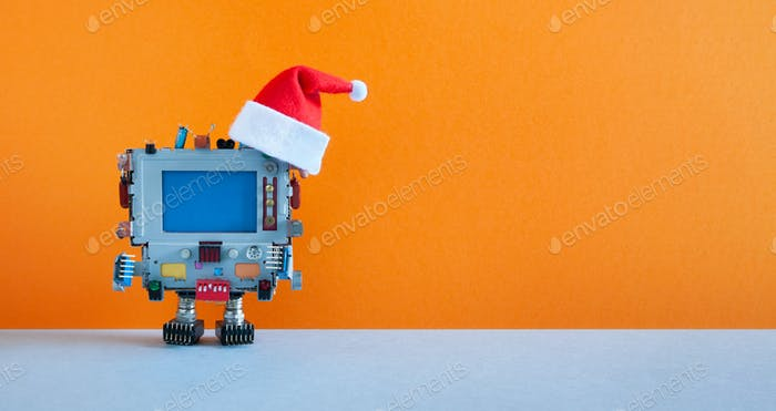 Santa Claus retro monitor computer toy on orange background.