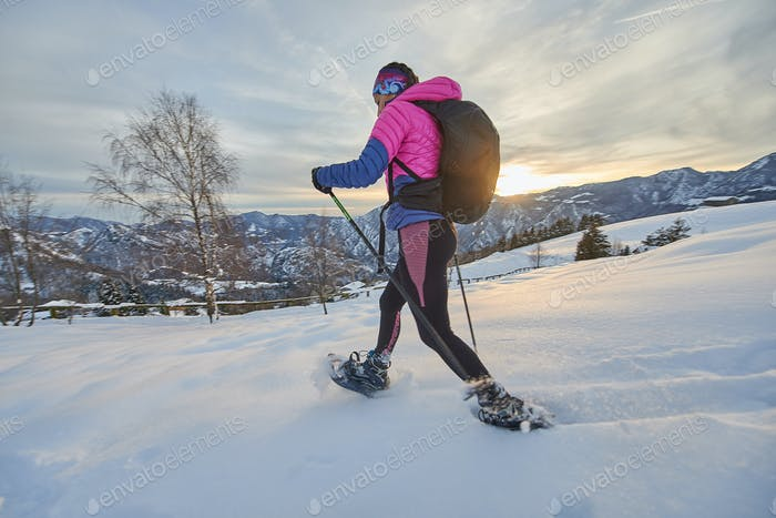 Girl in action with snowshoes