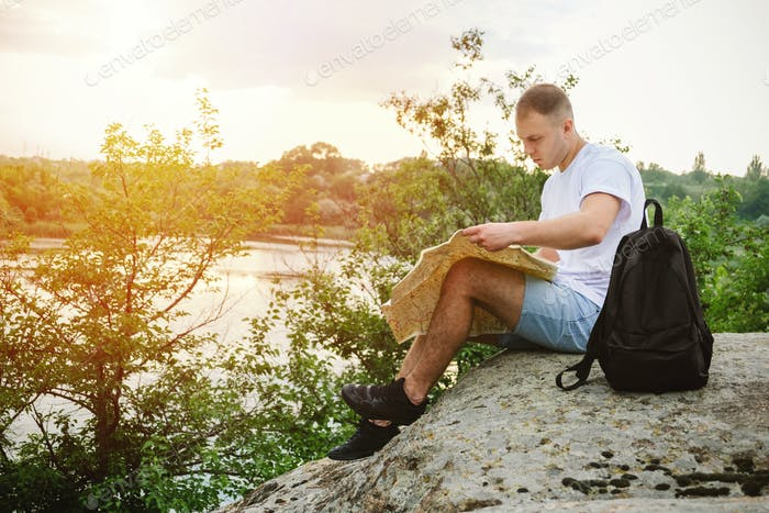Solo traveler, planning a solo vacation, vacation in locations visit alone. Man tourist sitting on a
