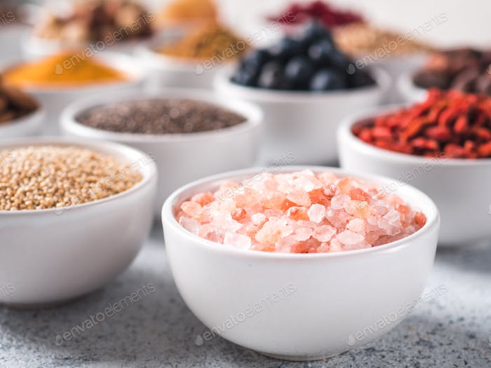 Pink salt in small white bowl and other superfoods