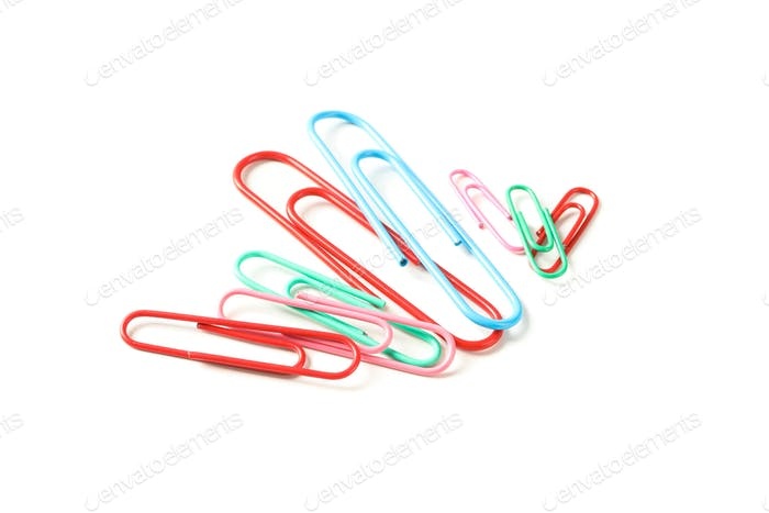 Color paper clips isolated on white background, closeup