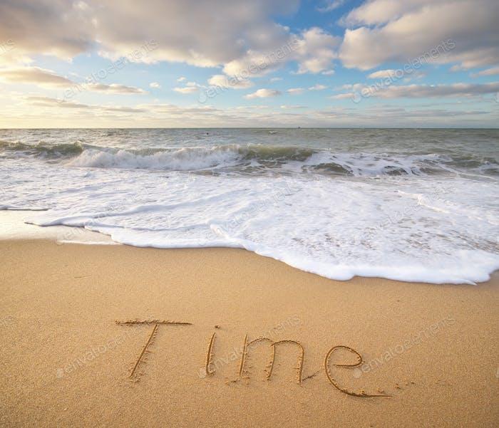 Zeitwort auf dem Meer Sand.