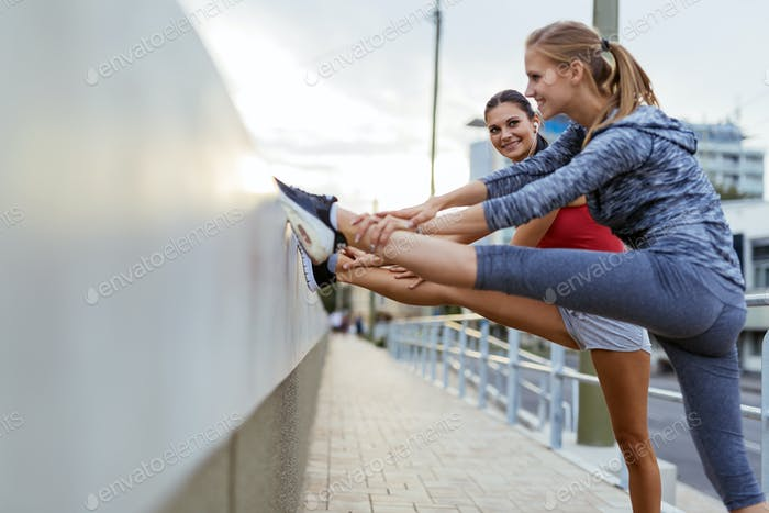 Two women stretching feet