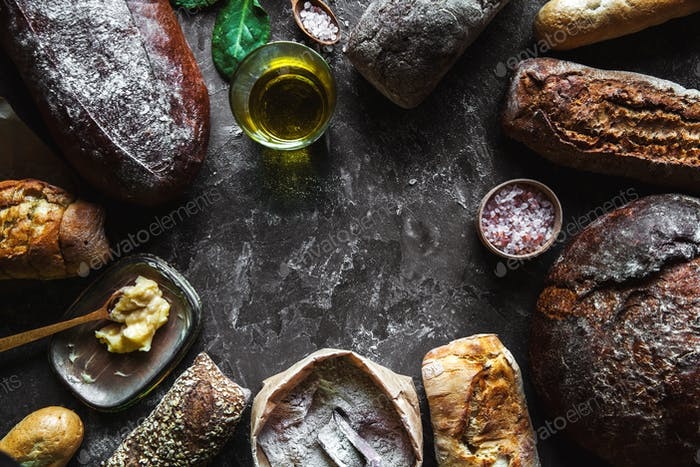 Bread on a black background. Homemade pastries with ingredients