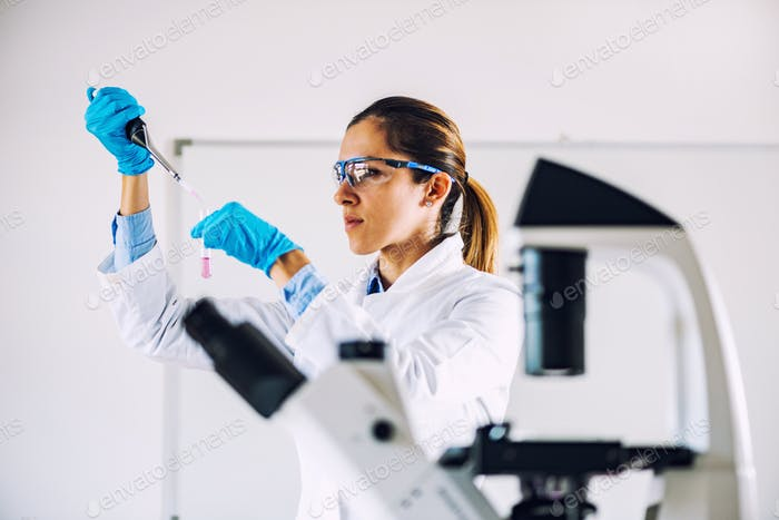 Young scientist working in her lab
