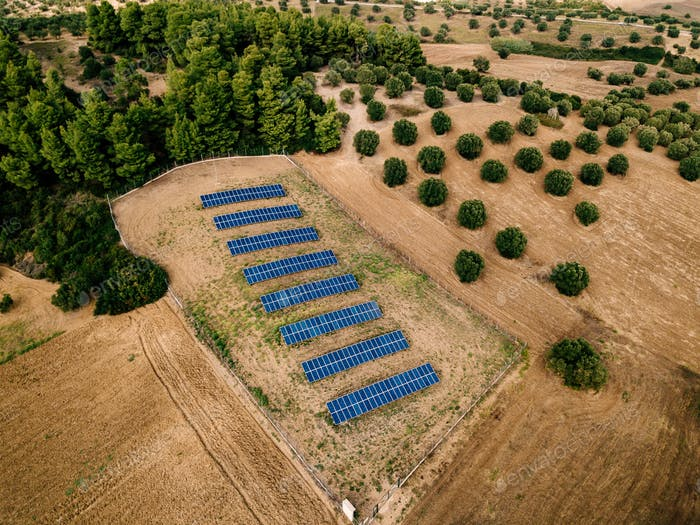 Aerial view of Solar panels farm in a field in the countryside in Greece.