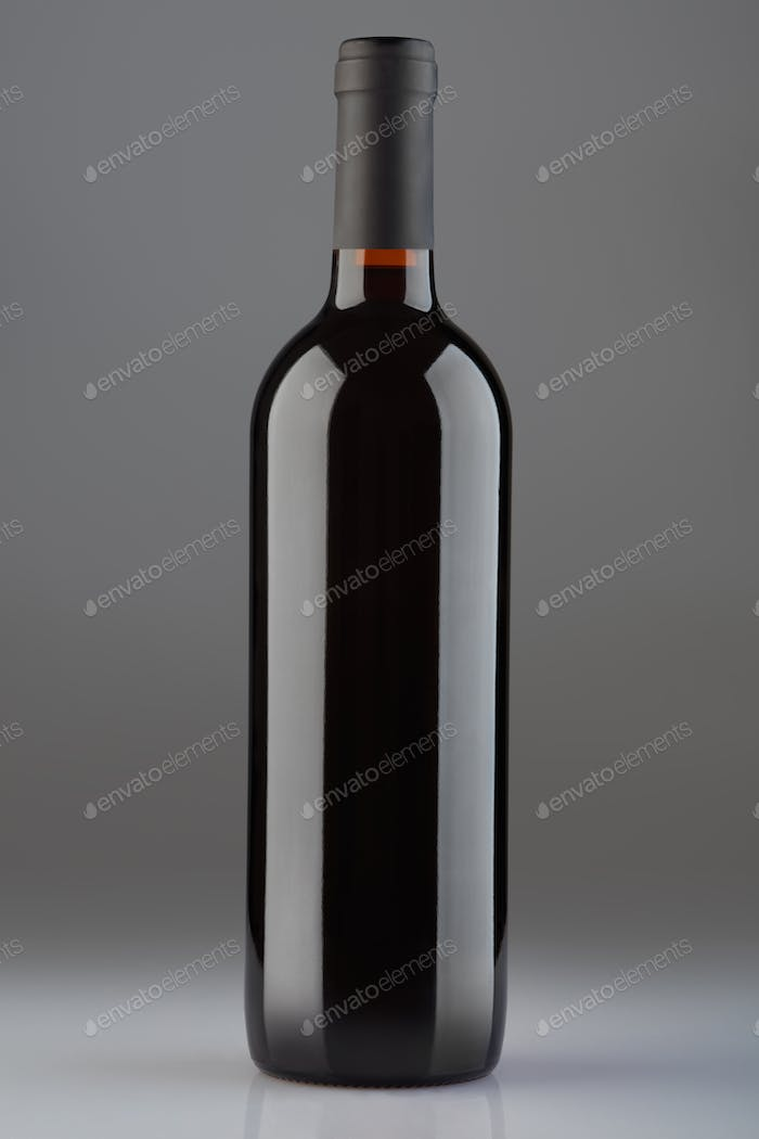 Red wine bottle on gray background, clipping path included
