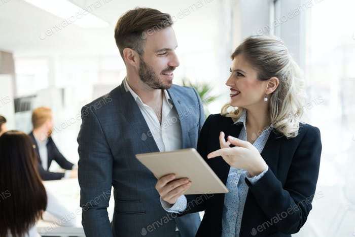 Professional business people cooperating in office