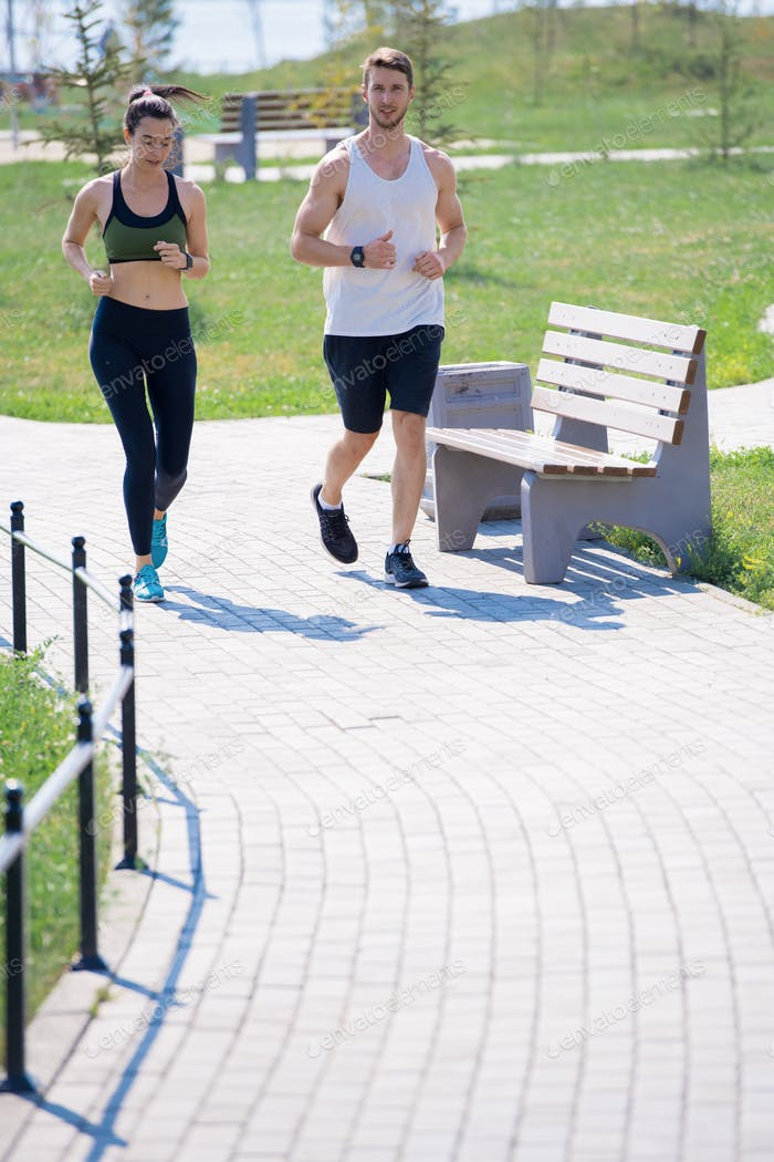 Active Young Couple Running