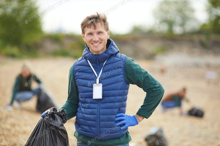 Volunteer with garbage outdoors