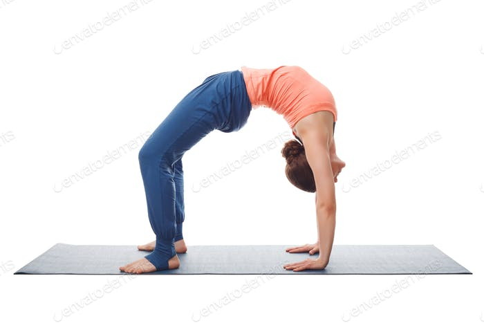 Beautiful sporty fit yogi girl practices yoga asana chakrasana
