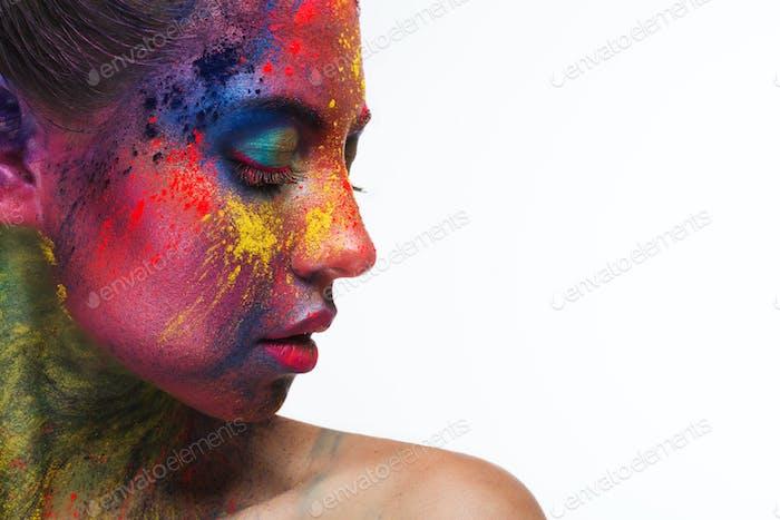 Beautiful woman portrait with bright art make-up
