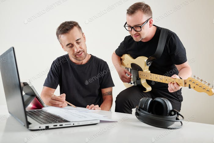 Musicians writing new song