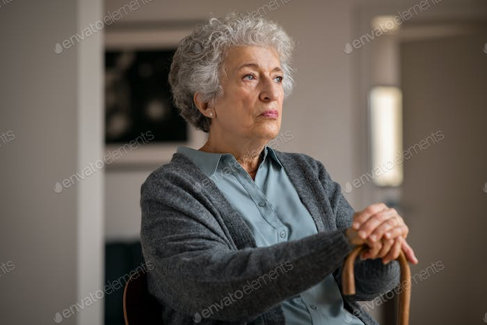 Lonely old woman at home