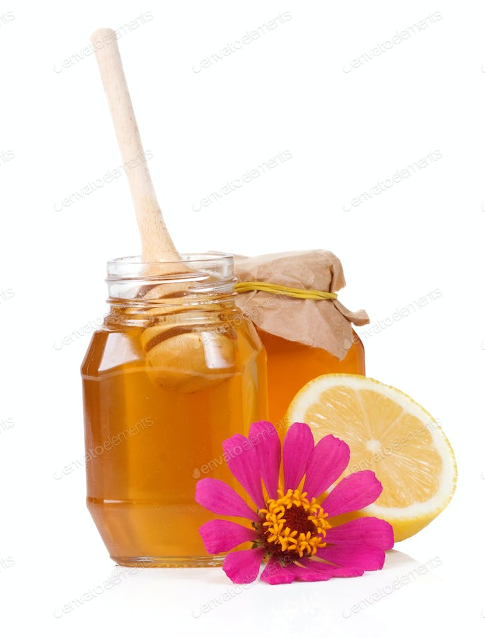lemon, flower and honey isolated on white
