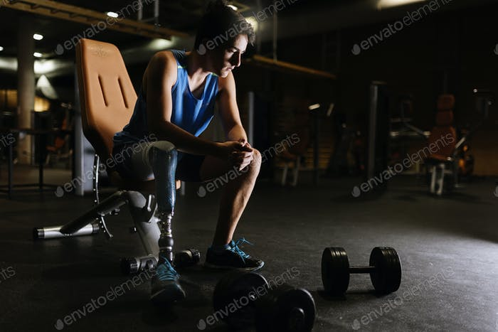 Portrait of disabled young man in the gym.