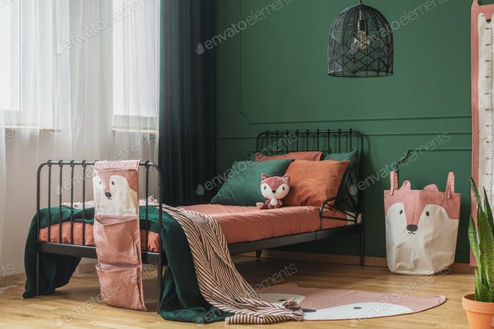 Fox theme in cute bedroom interior with green wall and orange bedding