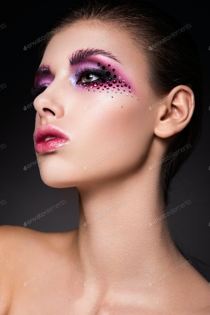 Beautiful woman with pink make up