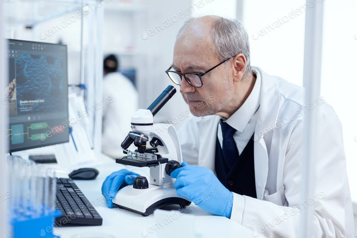 Senior man carrying out scientific investigation