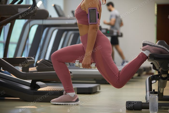 Unrecognizable Woman Working Out in Gym